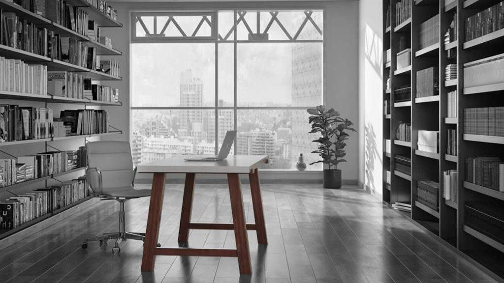 Contemporary desk with solid walnut legs and a white top in an urban modern office.