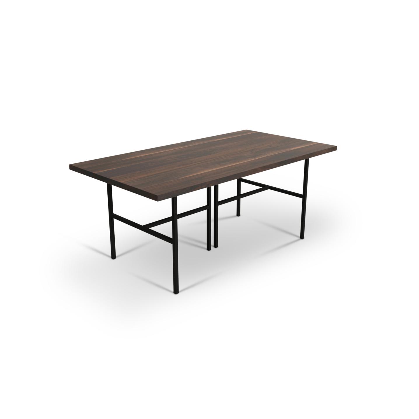 6 foot walnut table on black metal legs